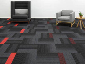 image of a carpet tile laid in the floor