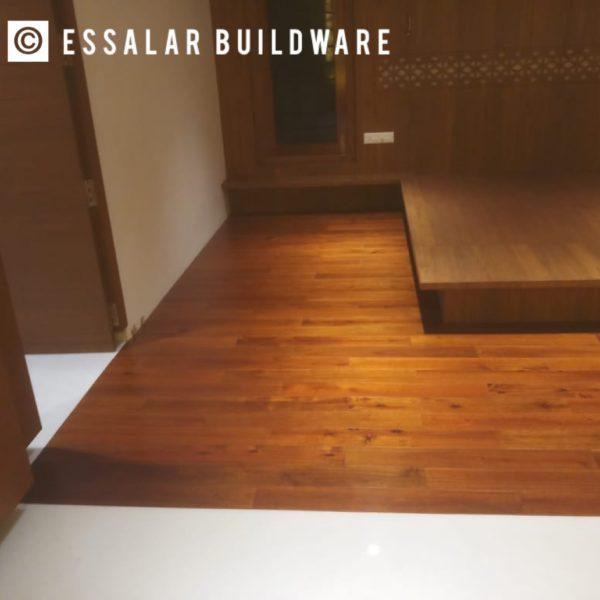 image of bedroom with wooden floor