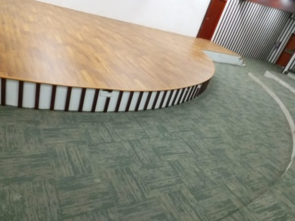 image of state with carpet and wooden flooring